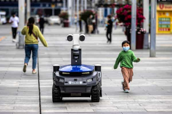 A police security robot near the high-speed railway station in Shenzhen, China, in March 2020. The machines warn people if they are not wearing masks, and check body temperature and identity.