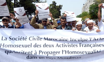 Moroccans demonstrate in Rabat against two topless French activists who kissed each other publicly in protest at Morocco's anti-gay laws.