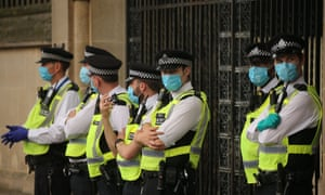 Police officers wearing face masks outside the Houses of Parliament during a demonstration by climate change action group Extinction Rebellion.