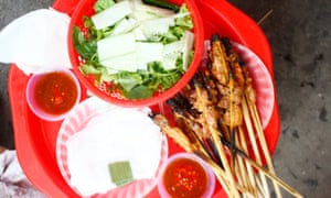 Close-up image of thịt nướng: grilled pork, chicken or prawns that come with some herbs and greens.