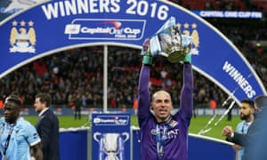 Manchester City goalkeeper Willy Caballero holds the trophy after he made three saves to win the penalty shootout during the English League Cup final soccer match between Liverpool and Manchester City at Wembley stadium in London, Sunday, Feb. 28, 2016. (AP Photo/Tim Ireland)