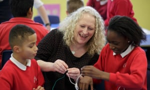 Sue Vermes, headteacher at Rose Hill primary school in Oxford with pupils in a class building electrical circuits