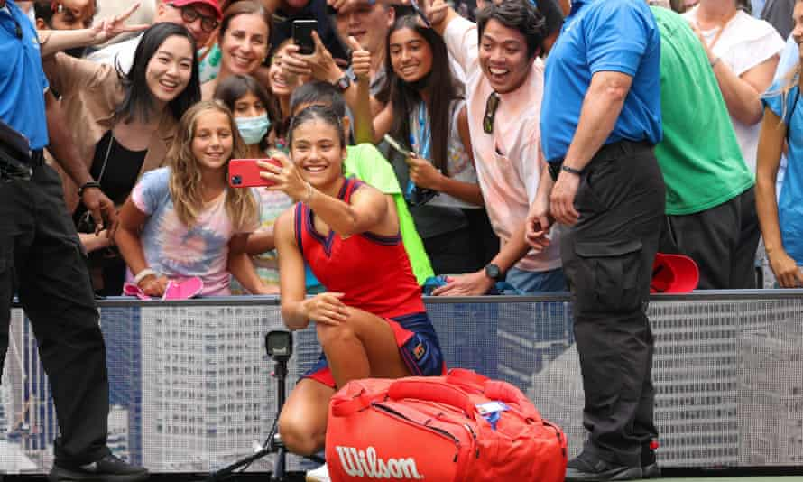 Emma Raducanu takes selfies with fans after her victory against Shelby Rogers at the US Open.