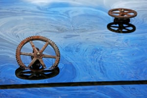 Rusted wheels in oily water