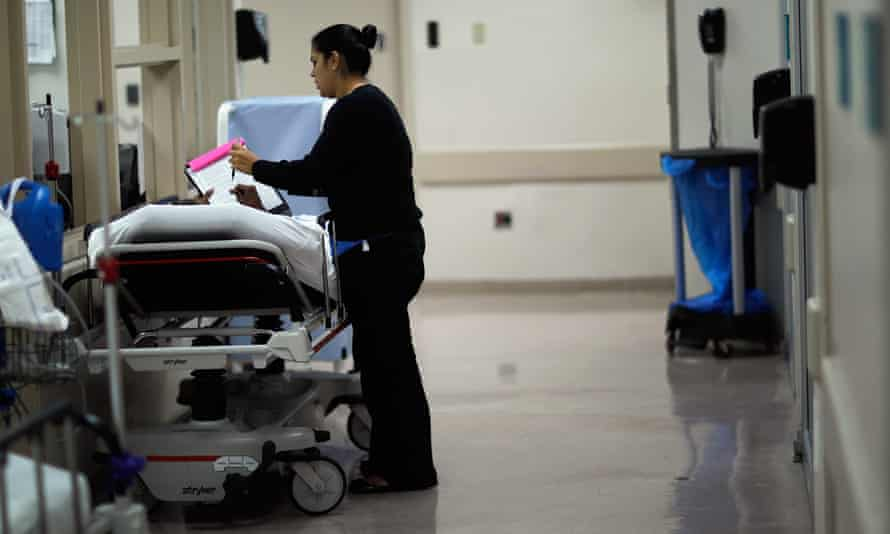 A patient receives help with paperwork in a Miami hospital.