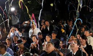 Fans of the Japanese writer Haruki Murakami celebrate after they heard that Japanese-born Kazuo Ishiguro won the Nobel Prize for Literature while they gather in a shrine with the hope of celebrating Murakami's winning in the prize in Tokyo, Japan, October 5, 2017. REUTERS/Kim Kyung-Hoon