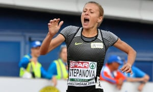 Russia's Yuliya Stepanova grimaces as she tries to finish the women's 800m heat at the European Athletics Championships in Amsterdam, where she was competing as a neutral with 'I run clean' on her vest.