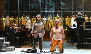 Luminous menace … Julie Mathevet as the Assistant and Jarrett Ott as the Prisoner in David Lang's Prisoner of the State performed by the BBC Symphony Orchestra and BBC Singers, conducted by Ilan Volkov at the Barbican Hall on Saturday.