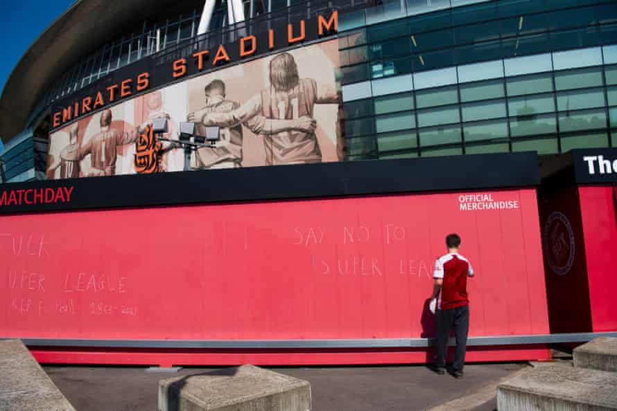 A fan writing some €$L graffiti down at the Emirates.