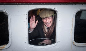 Nigel Farage looks out from a window on the Kestrel crabbing boat in Grimsby fish dock.