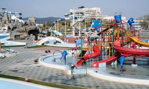 Workers clean and repair the outside area of the Munsu water park, in preparation for the summer season. In Pyongyang, North Korea.