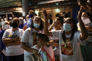 People attend a mass held in tribute to the victims of a fatal police operation in Jacarezinho favela