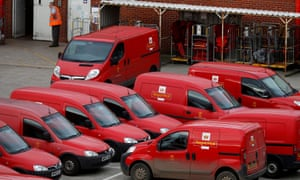 A Royal Mail postal worker stands in the yard of a sorting office in Altrincham.