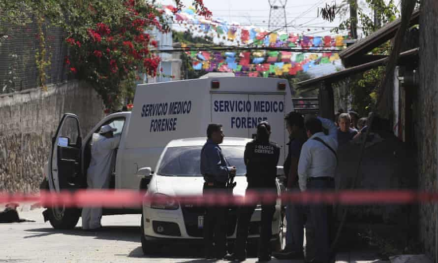 Police officers and a forensic technician stand at a crime scene where the newly installed mayor Gisela Mota was reportedly attacked at her home by four armed gunmen in Temixco, Mexico.