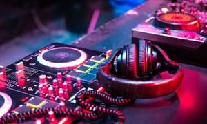 DJ music console in nightclub