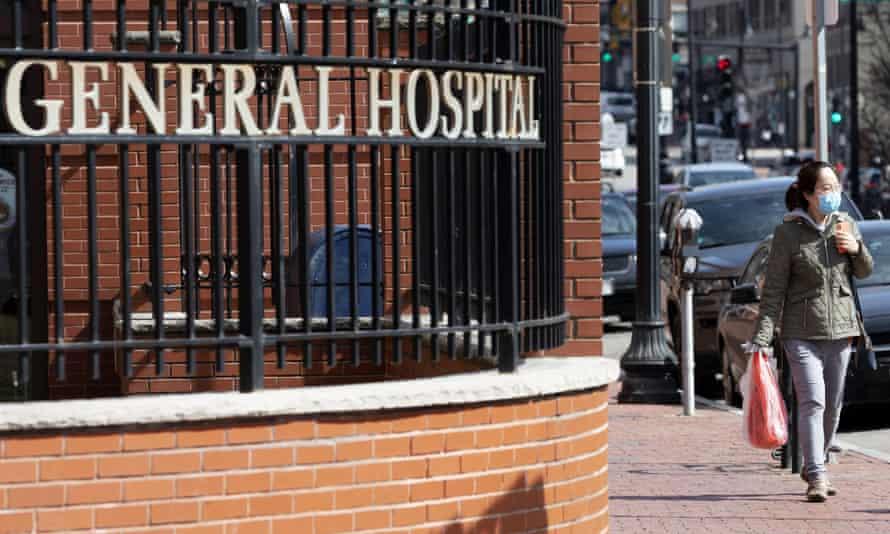 A woman wears a mask outside Massachusetts General Hospital in Boston on Saturday.