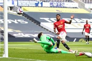 Fred scores his team's first goal past Hugo Lloris of Tottenham Hotspur.