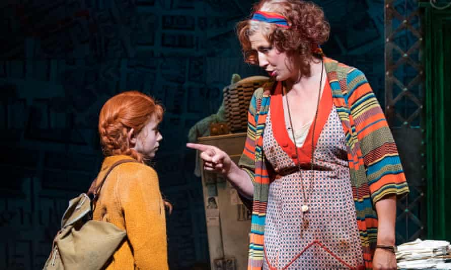 Miranda Hart, putting her swoop of height to good effect, with Ruby Stokes in Annie.