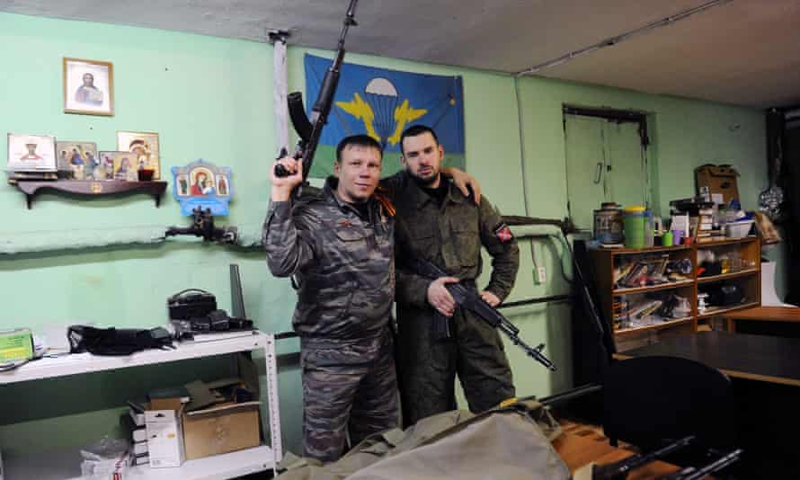 In this 2015 photo, Dmitry Gaydun and Sergei Zinchenko, two members of the Russian Imperial Movement, are shown at a training base in St Petersburg.