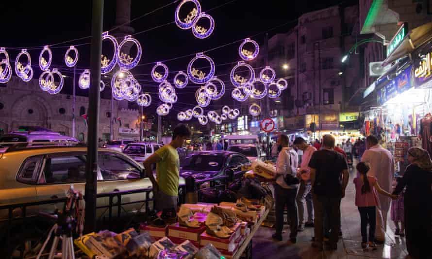 Jordanians shop before Eid al-Fitr in Amman.