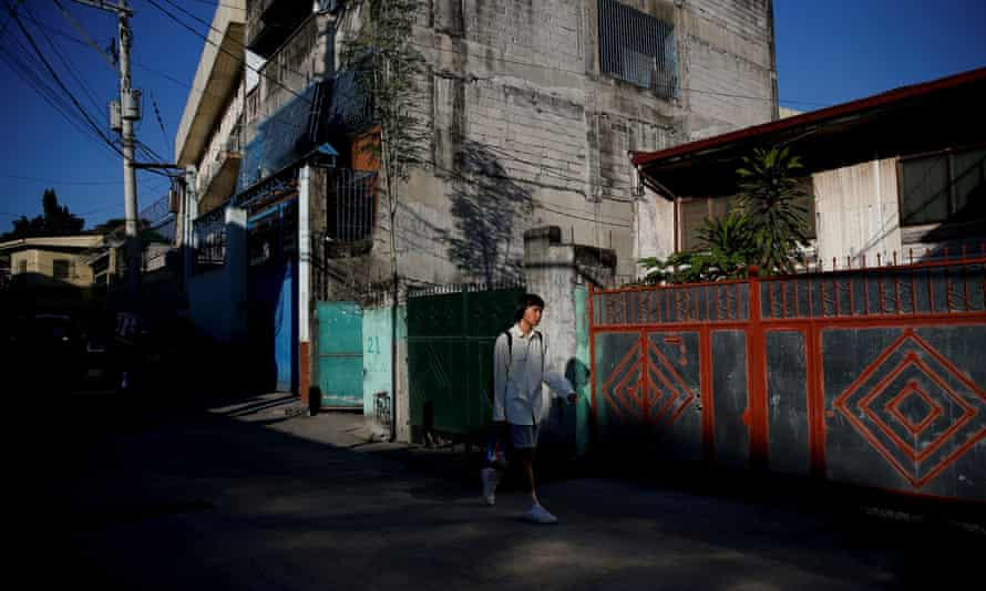 Oliver Emocling, 23, who works for a magazine, leaves his neighbourhood in Caloocan city