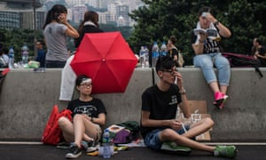 Protesters relax on the streets outside the Hong Kong Government Complex