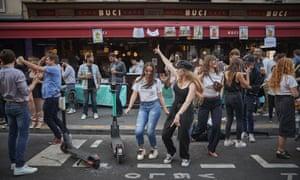 Parisians dance in the street at Fête de la Musique, 21 June.