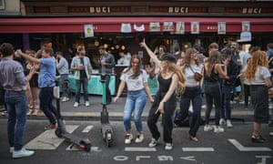Young Parisians dance in the street at a bar in the 6th Arrondissement as Paris celebrates the first day of summer
