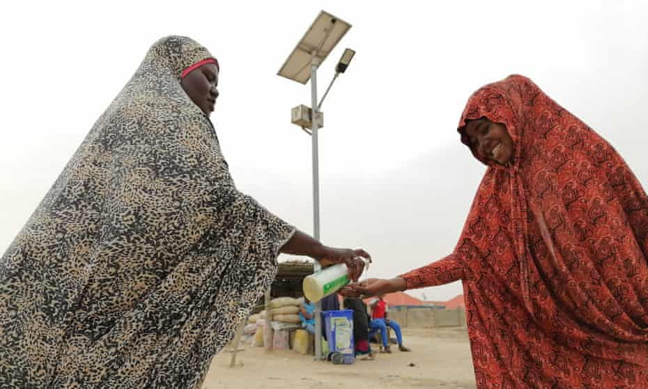 A woman dispenses soap at the Bakassi internally displaced people's camp in north-east Nigeria.