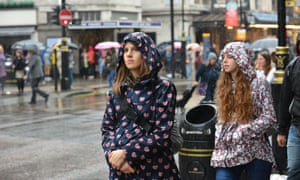 Rain-soaked women in Oxford Street, central London.