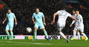 Leeds United's Jack Harrison scores his team's second goal .