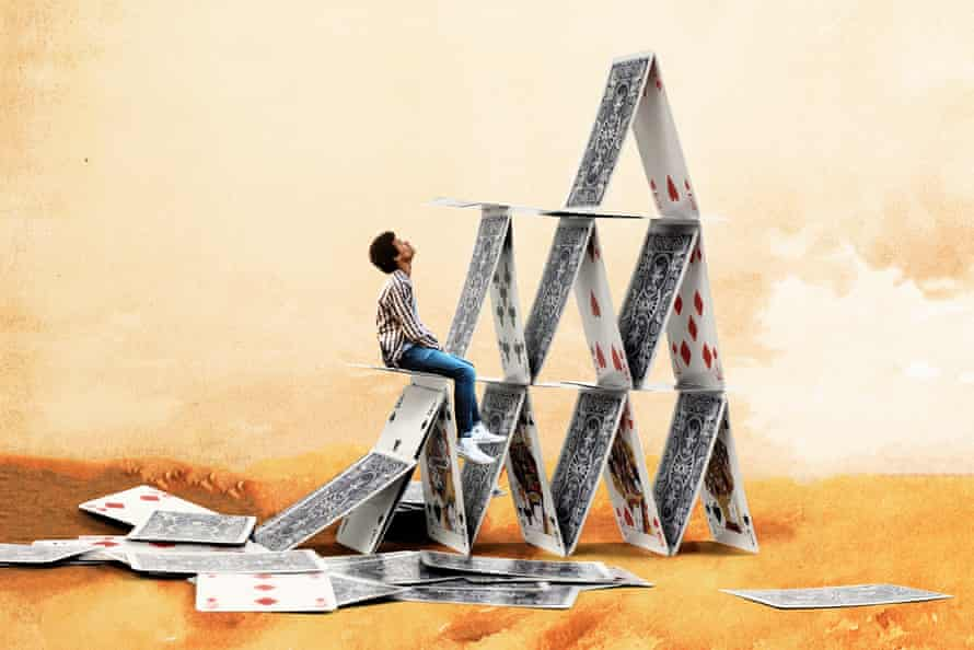 Man sitting on house of cards