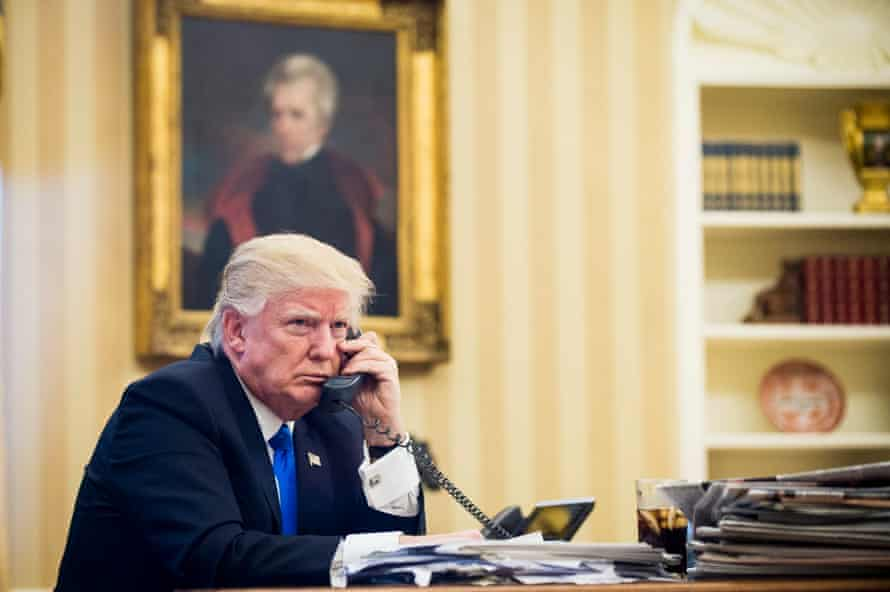The US president, Donald Trump, discusses the refugee deal with Australia with the former prime minister Malcolm Turnbull