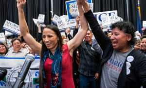 Democratic House candidate from Kansas Sharice Davids and her mom Crystal (R) celebrate after Davids won her race. Davids is the first lesbian Native American congresswoman.