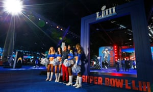 Los Angeles Rams cheerleaders pose for pictures with fans in Atlanta