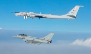 A Typhoon from RAF Lossiemouth intercepts a Russian Tu-142 'Bear' bomber as it approaches UK air space in a Ministry of Defence photograph issued on March 11.