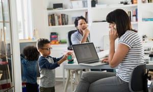 A family using computers and a mobile phone