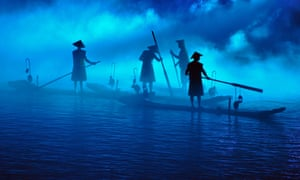 By David Paul Elliott. Fishermen on the river Li in China. These boatmen participate in an illuminated display, for tourists, which takes place as evening comes. The visual impact is stunning.