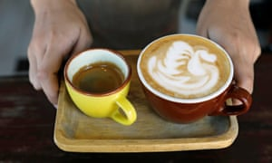"""Coffee serving style called """"Duet"""", a cup of cappucino and a shot of espresso is pictured at Magnum Opus coffee shop in Paranaque, Metro Manila, Philippines May 5, 2017. REUTERS/Erik De Castro"""