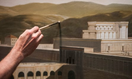 A painter works on a mural at the Museum of the Bible