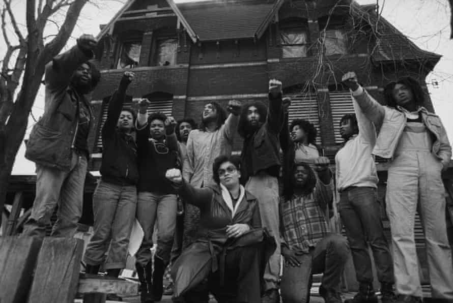 Move members in front of their house in the Powelton Village section of Philadelphia, Pennsylvania.