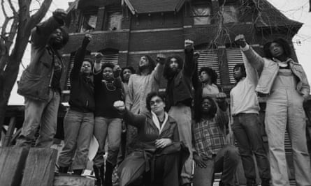 Members of Move in front of their house in the Powelton Village section of Philadelphia