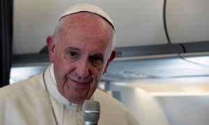 Pope Francis speaks to reporters on papal plane