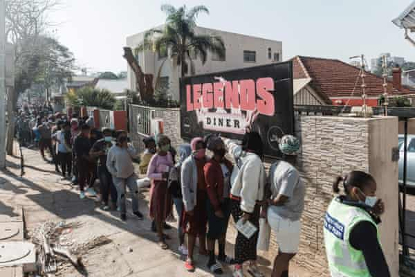 People queue for food and baby items distributed by Muslims For Humanity at Legends Diner, KwaZulu-Natal.