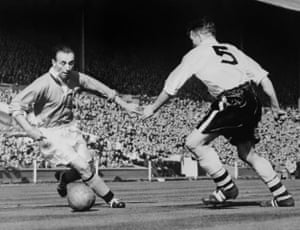 Blackpool's Stanley Matthews (left) dribbles past Bolton's Malcolm Barrass during the 1953 FA Cup final.