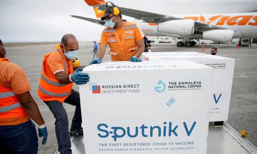 Workers handle a shipment of Russia's Sputnik V vaccine in Caracas, Venezuela, in March.