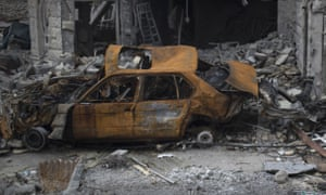 'We'd have to take care / of the cars of course' A bombsite in Mosul, Iraq.