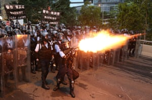 Police officers fire teargas at the protesters