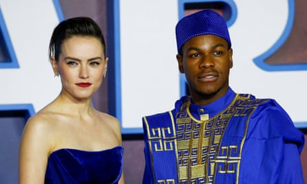 Daisy Ridley and John Boyega pose as they attend the premiere of Star Wars: The Rise of Skywalker in London