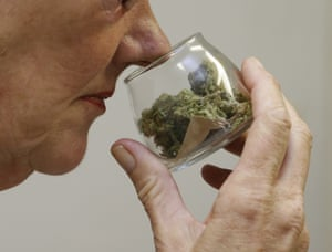 A customer checks the aroma of a jar of medicinal marijuana at a dispensary in Sacramento.